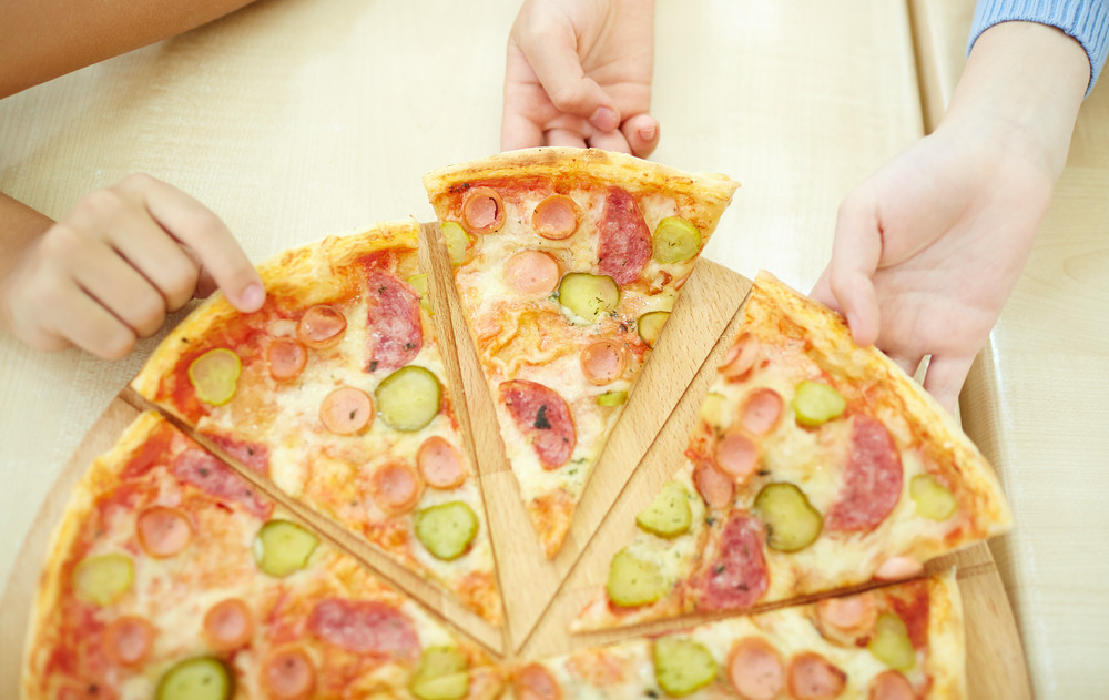 Children Taking Pieces Of Pizza