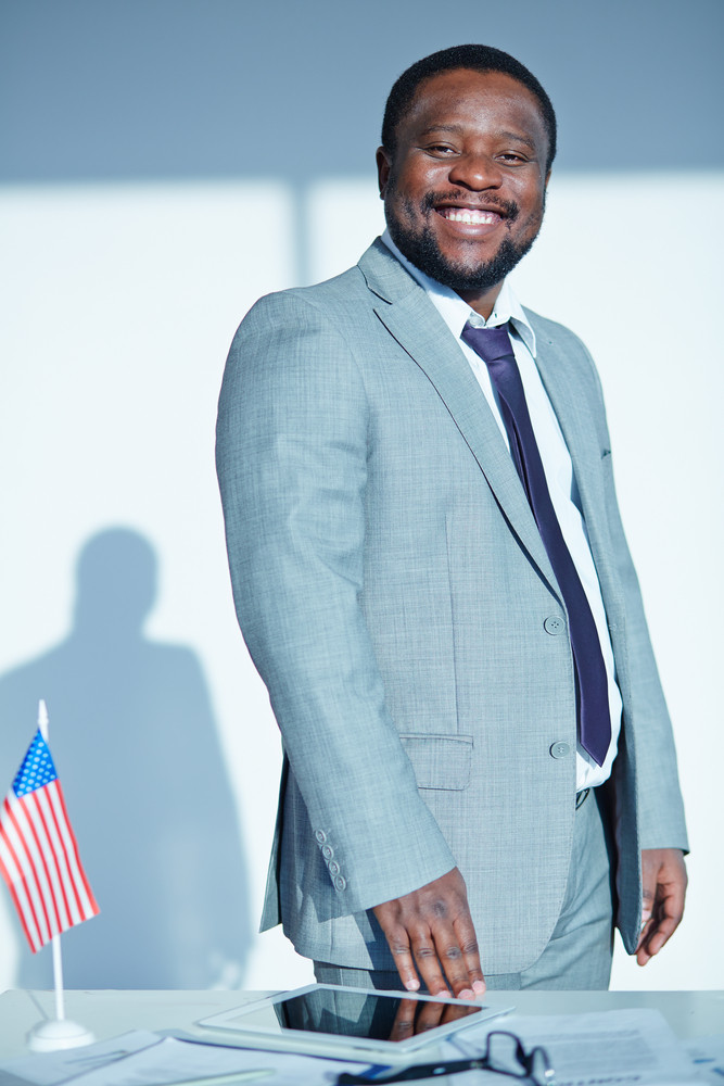 Happy African-american Businessman Looking At Camera