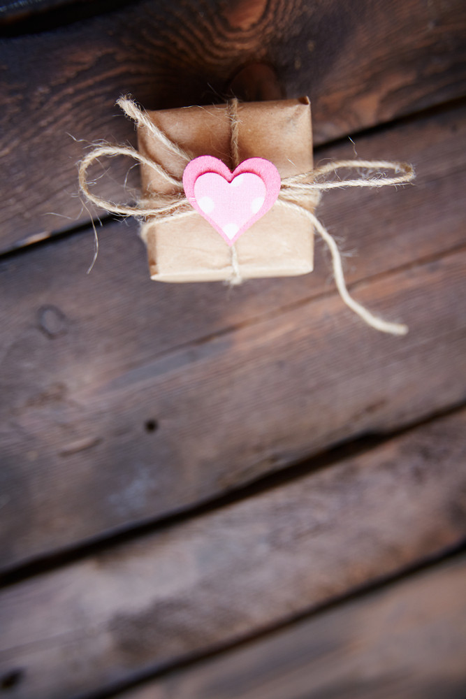 Vertical Image Of Valentine Giftbox With Small Pink Heart On Wooden Background