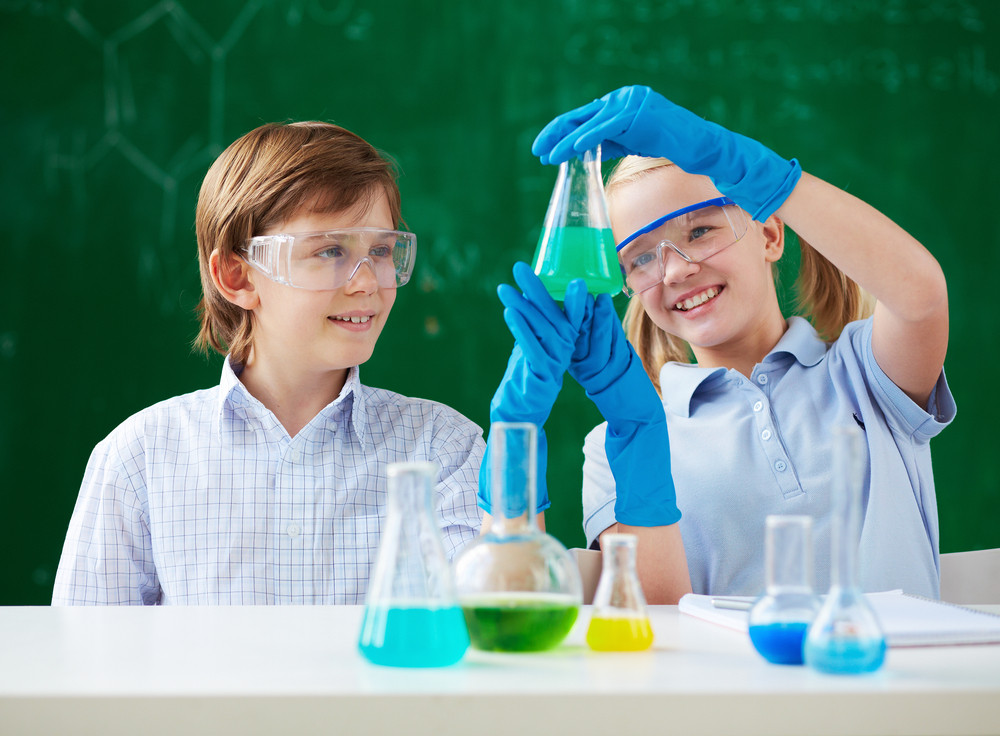 Two Children Looking At Tube With Chemical Liquid
