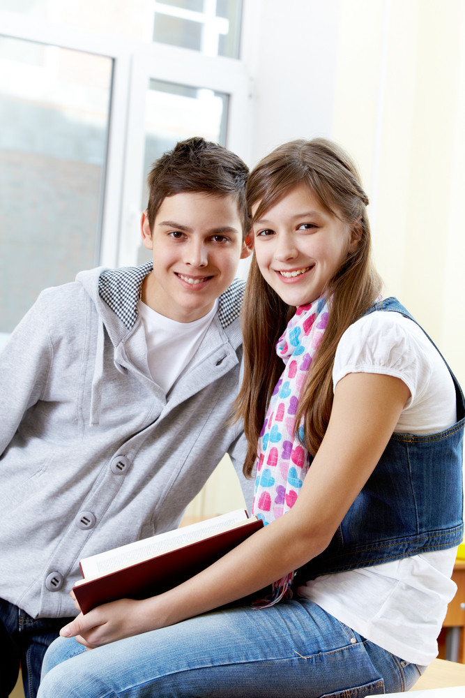 Portrait Of Happy Guy And Girl Looking At Camera