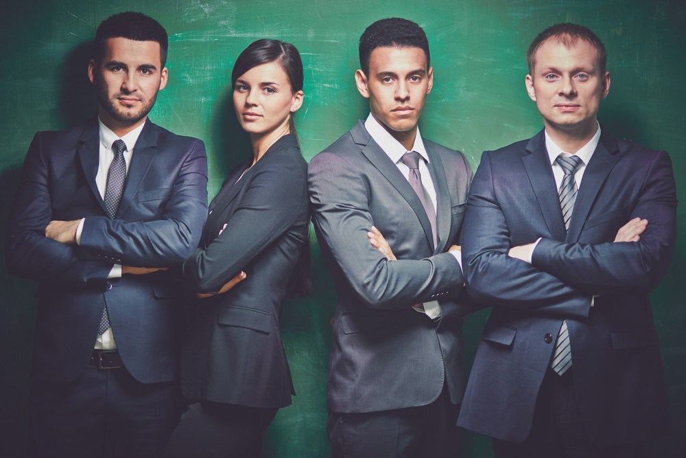 Group Of Elegant Business Partners Looking At Camera On Green Background