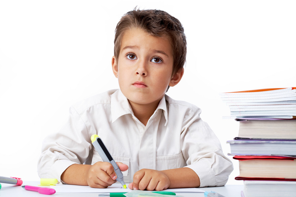 Portrait Of A Little Schoolboy Drawing
