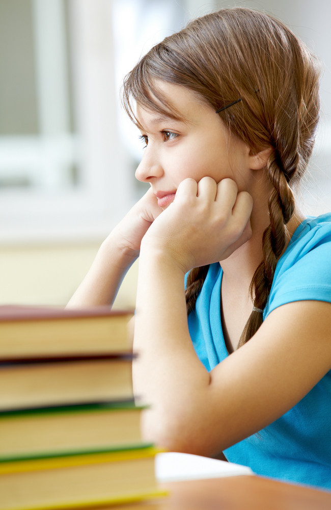 Portrait Of Pretty Girl At Workplace Interested In Subject