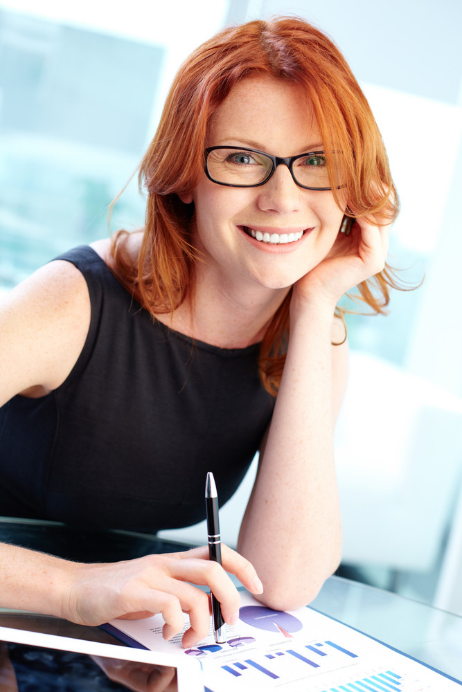 Successful Business Lady Smiling At The Camera While Working In Office