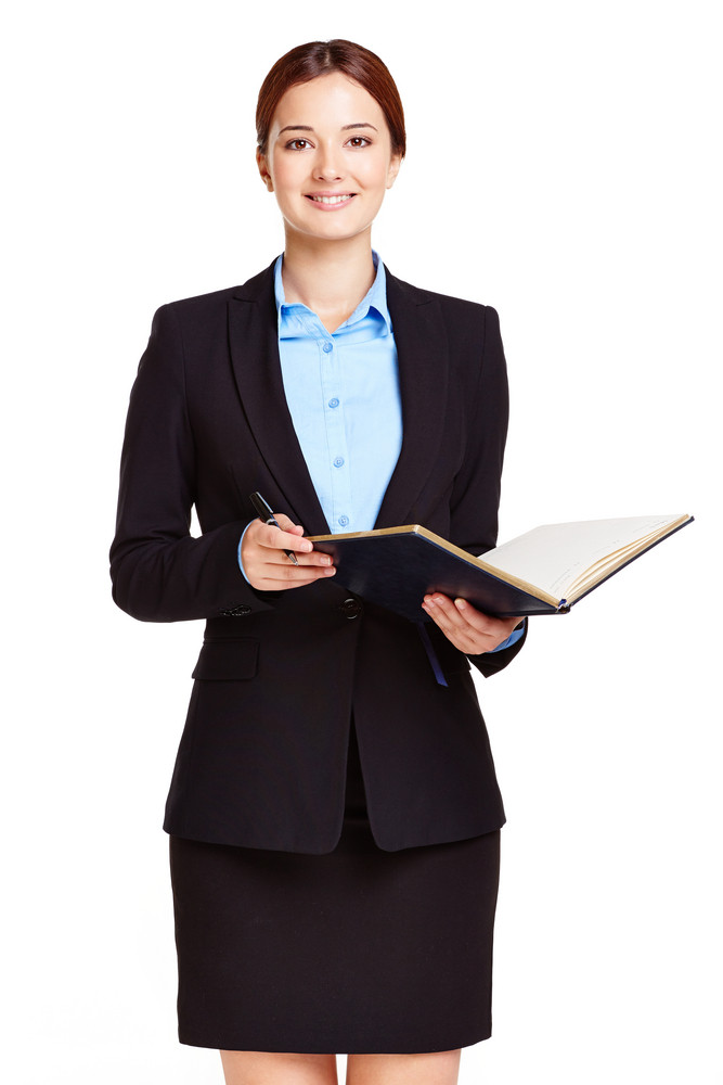 Portrait Of Young Businesswoman With Open Notepad Looking At Camera