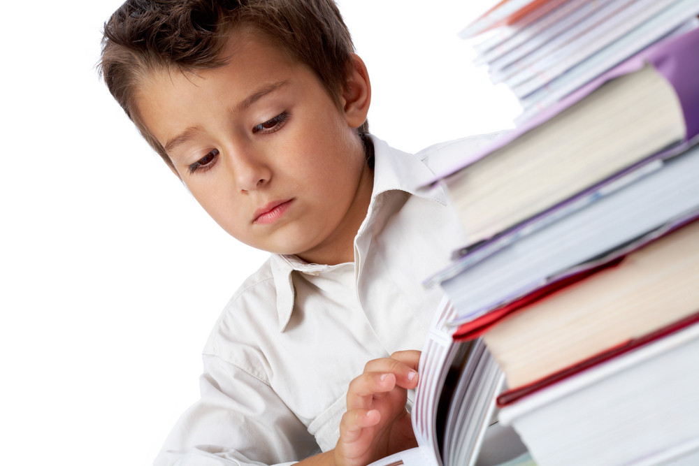 Photo Of Pensive Youngster Looking At Page Of Open Book
