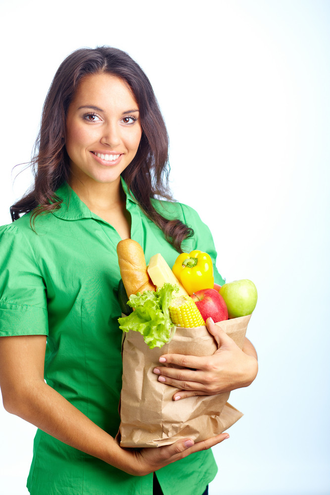 Portrait Of Pretty Girl With Big Paper Sack Full Of Healthy Food In Isolation