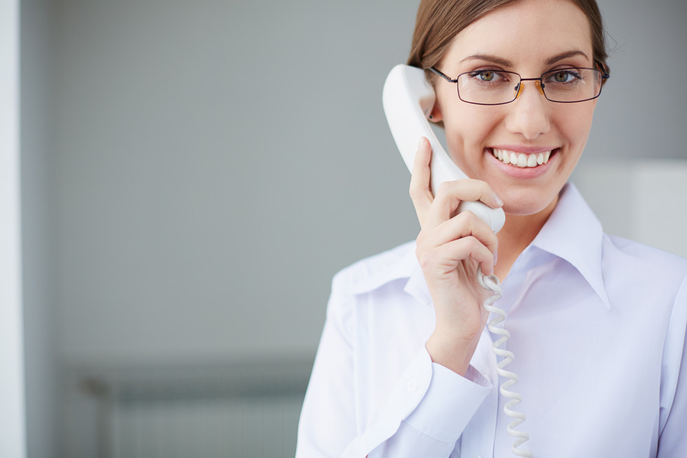 Young Businesswoman Looking At Camera While Speaking On The Phone