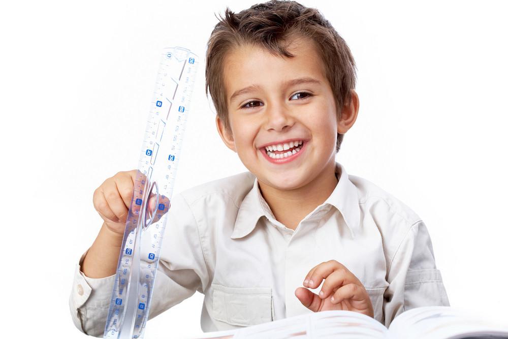 Portrait Of A Little Schoolboy Holding A Ruler