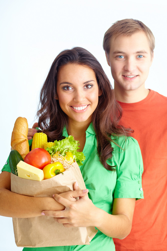 Happy Couple Of Healthy Eating Followers Looking At Camera