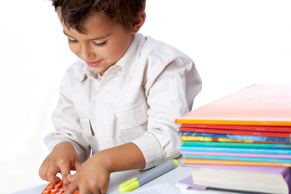 Portrait Of Positive Schoolkid Playing School Game In Isolation