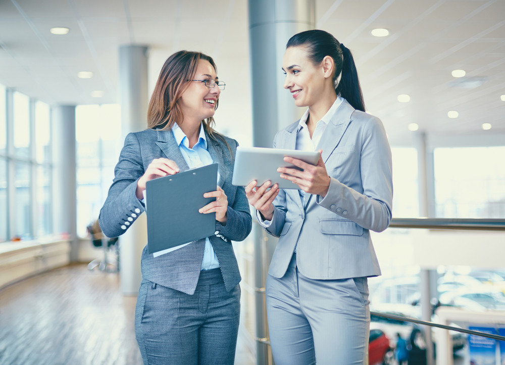 Image Of Confident Businesswomen Interacting At Meeting