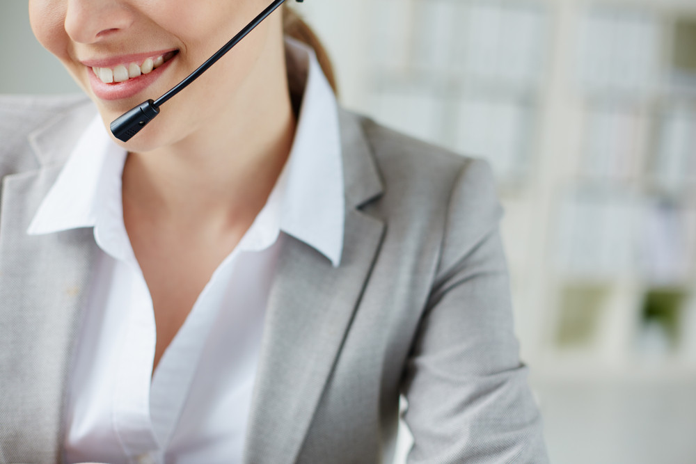 Toothy Smile Of Young Businesswoman With Headset