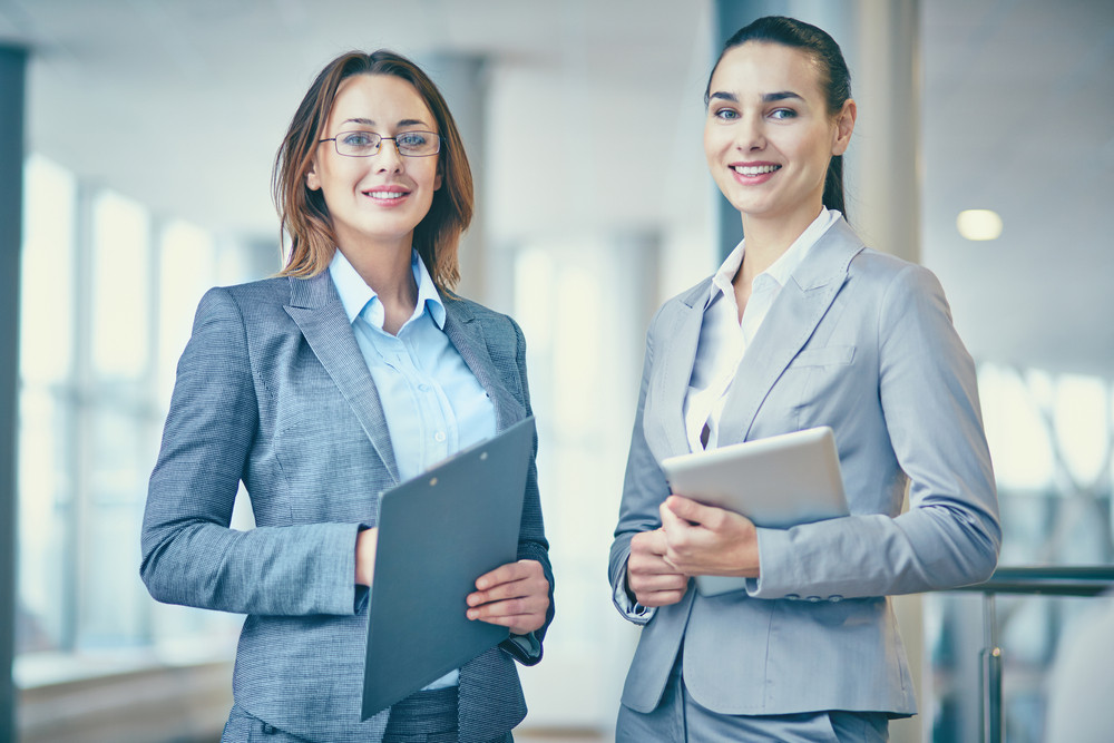 Image Of Two Confident Businesswomen Looking At Camera