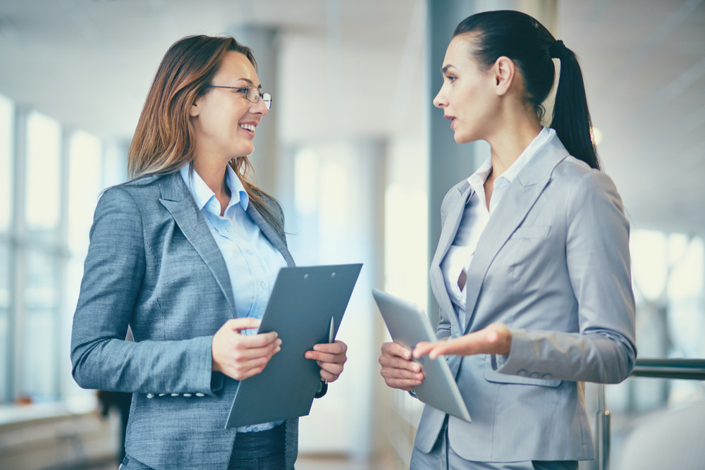 Image Of Two Confident Businesswomen Talking