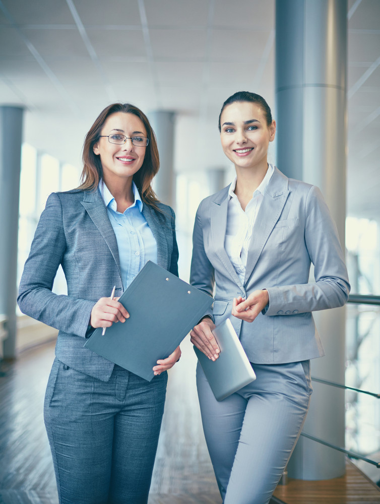 Image Of Two Confident Businesswomen Looking At Camera With Smiles