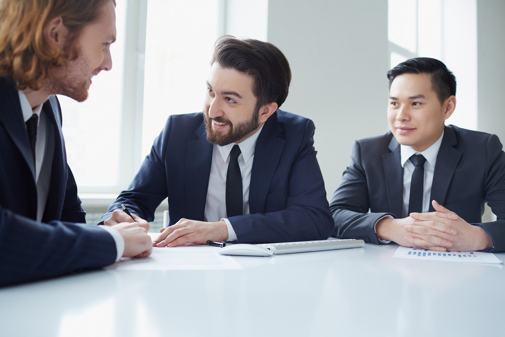 Three Managers Discussing Business Plans In Office