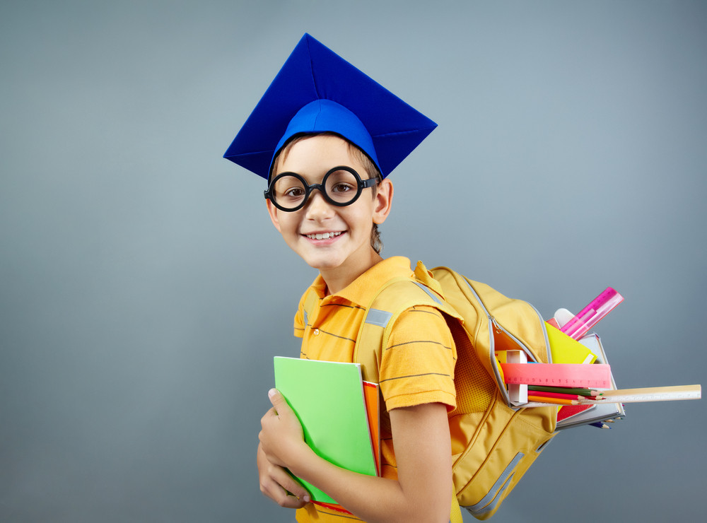 Portrait Of Happy Schoolkid With Backpack Looking At Camera