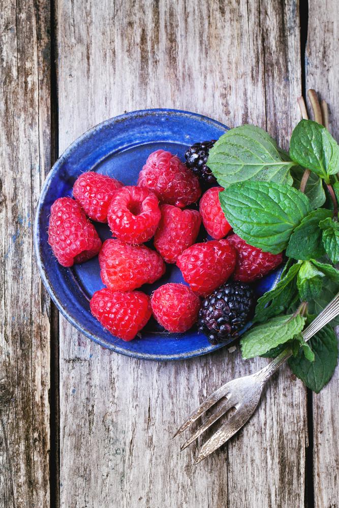 Plate Of Raspberries And Blackberries