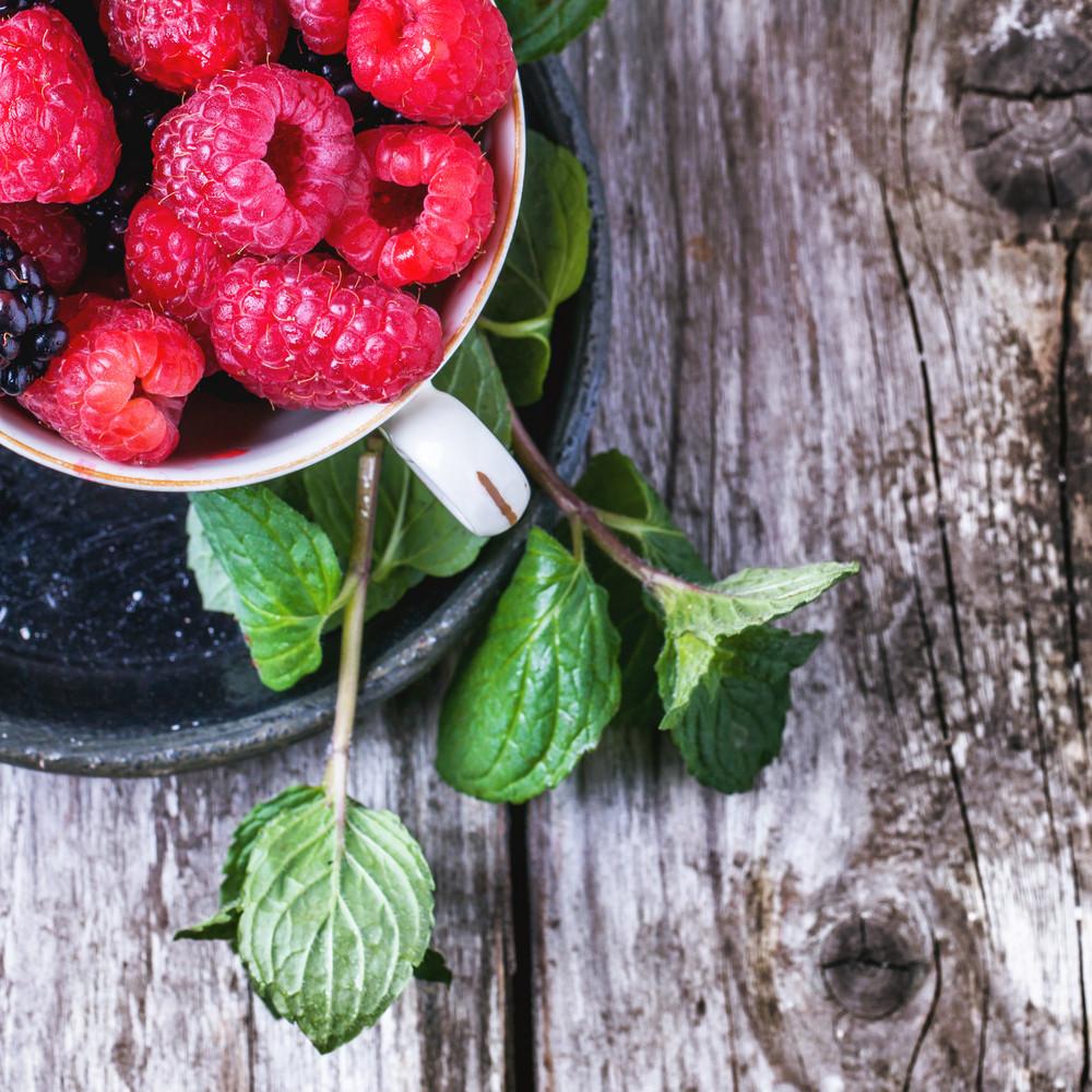 Cup Of Raspberries And Blackberries