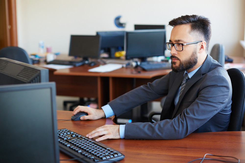 Asian Businessman Using Computer In Office