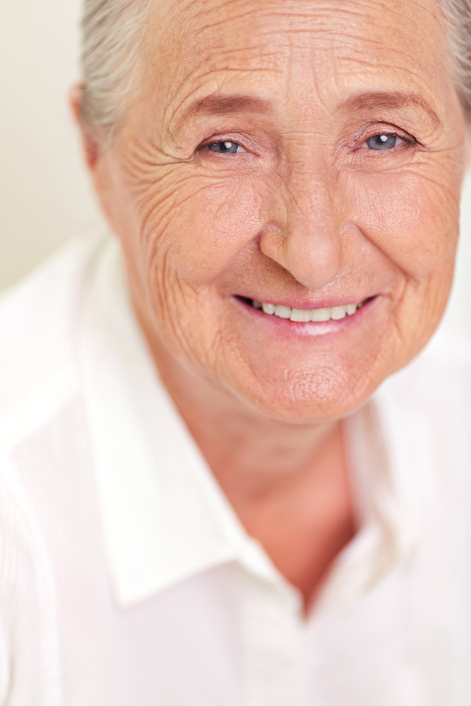 Face Of Elderly Female Looking At Camera With Smile