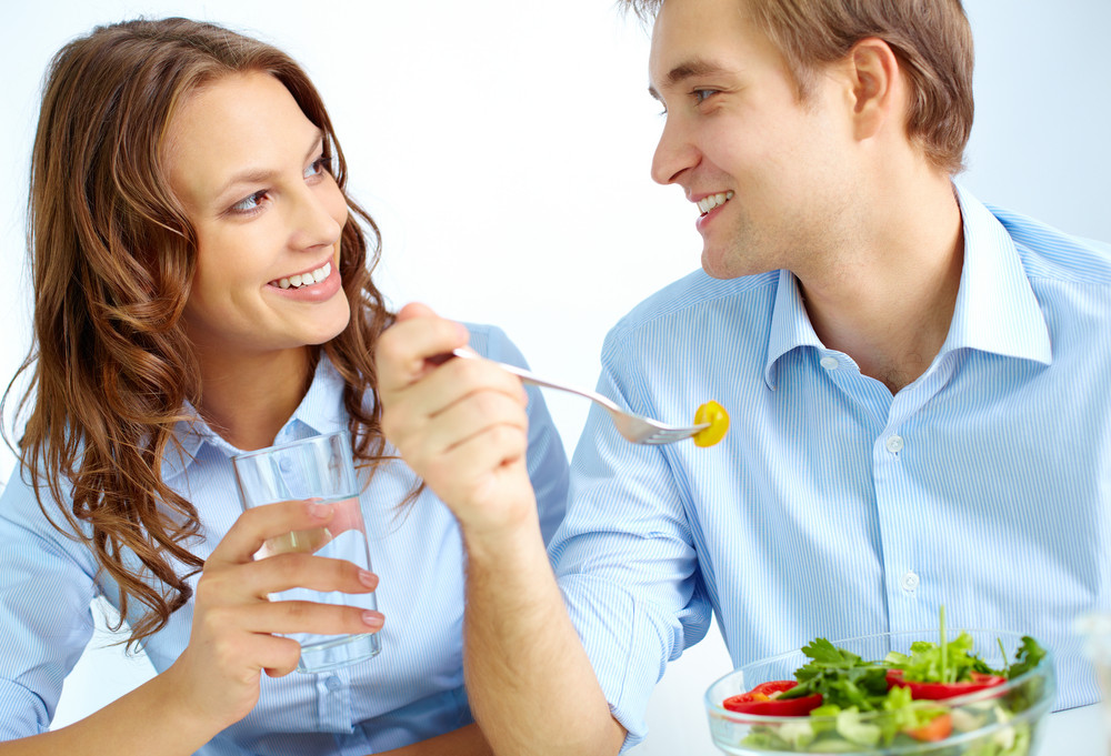 Happy Young Couple Having Breakfast