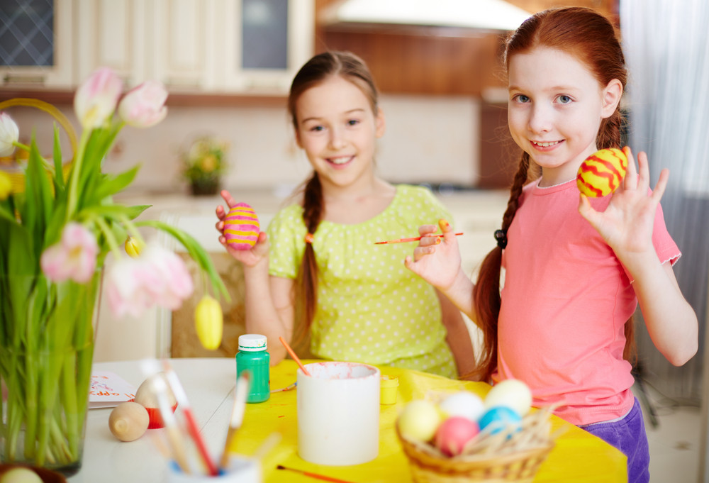Two Girls Showing Their Painted Easter Eggs