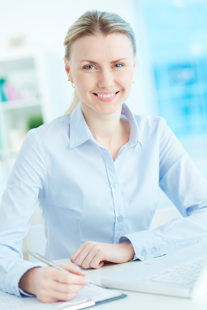 Portrait Of Successful Businesswoman At Workplace Looking At Camera