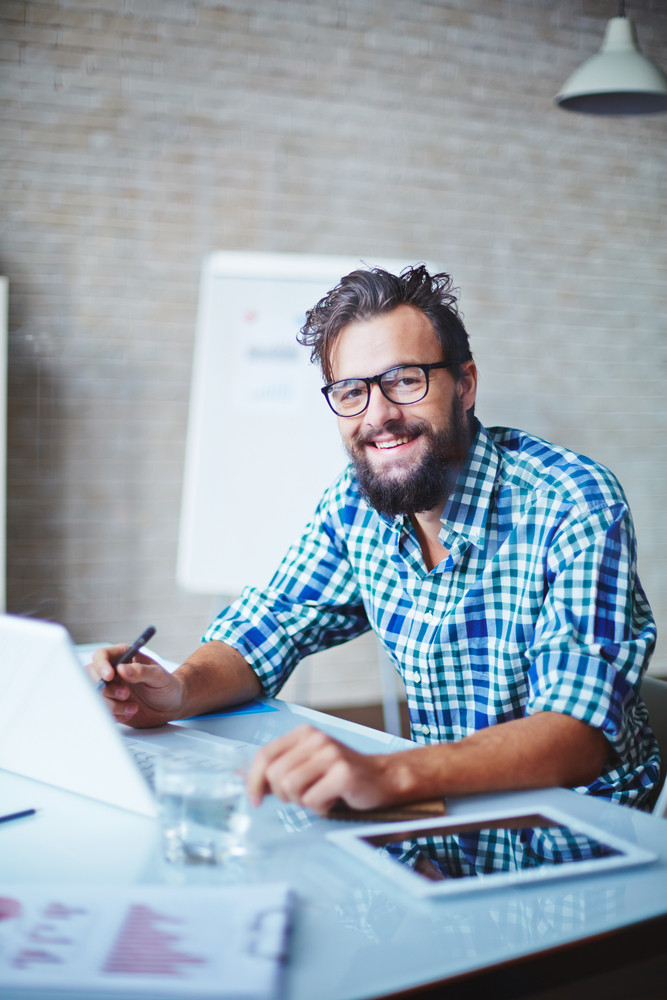 Young Businessman In Casualwear And Eyeglasses Working In Office