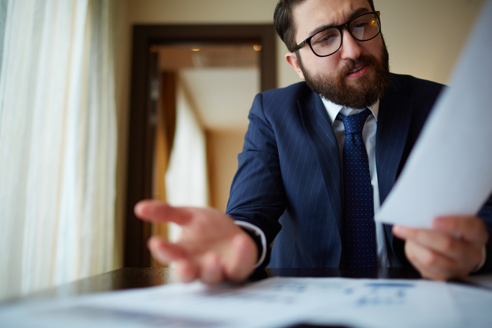 Elegant Businessman Working With Document In Office