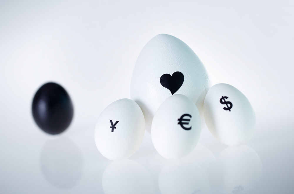 Image Of Big White Egg With Heart Surrounded By Three Small Eggs With Currency Signs