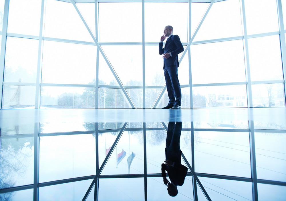 Image Of Successful Businessman Speaking On The Phone On Background Of Window