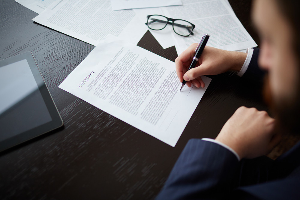 Image Of Businessman Hand With Pen Signing Contract At Workplace