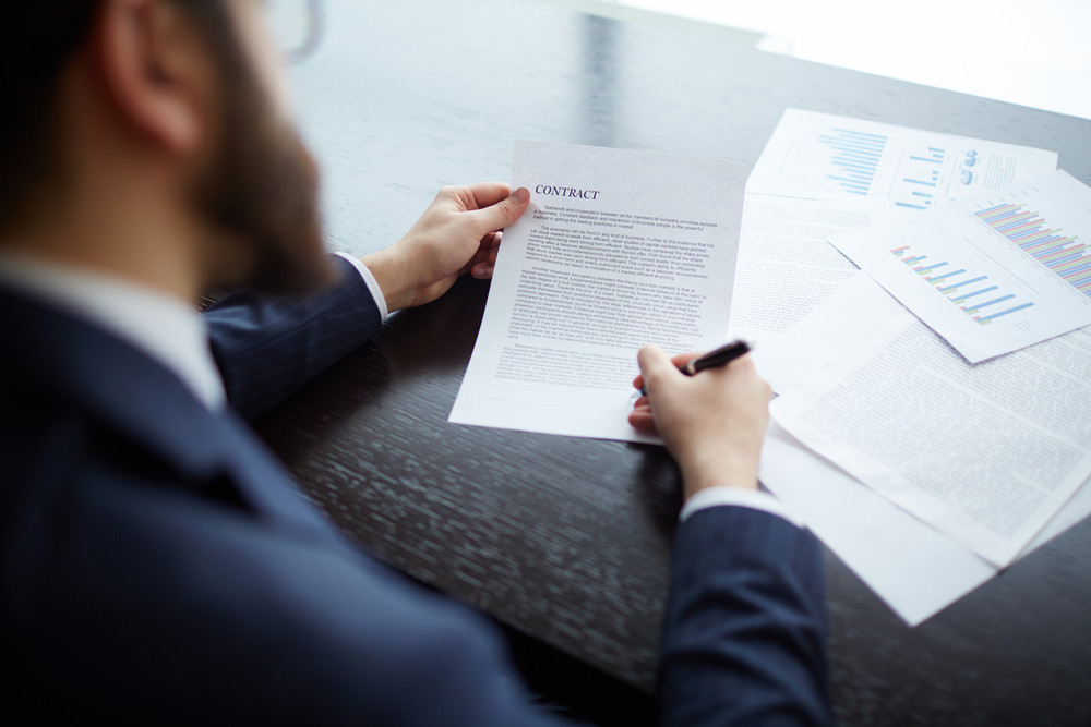 Image Of Businessman Signing Contract At Workplace
