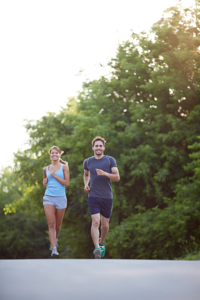 Photo Of Happy Couple Running Outdoors
