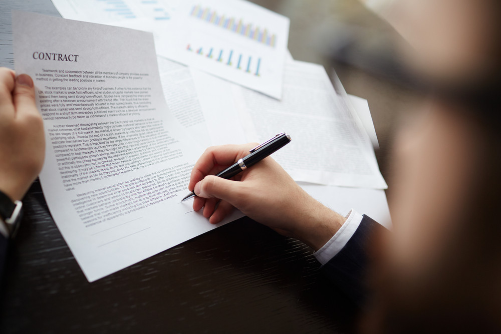 Image Of Businessman Hand With Pen Signing Contract