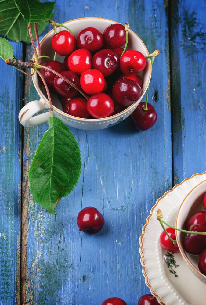 Fresh Cherries In Vintage Tea Cup