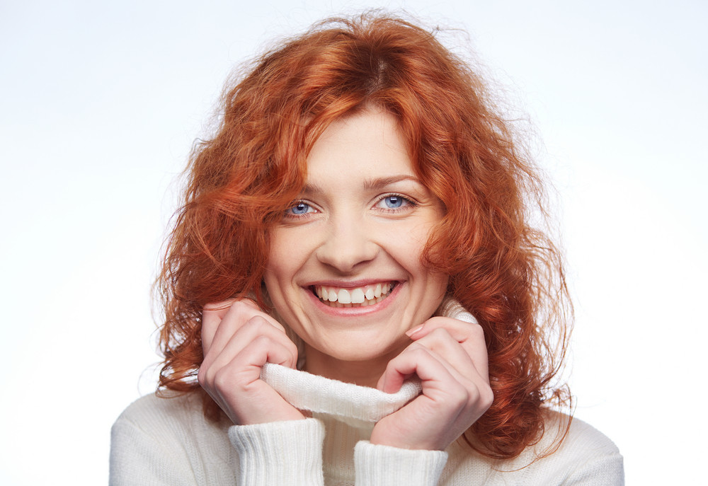 Portrait Of A Happy Red-haired Girl