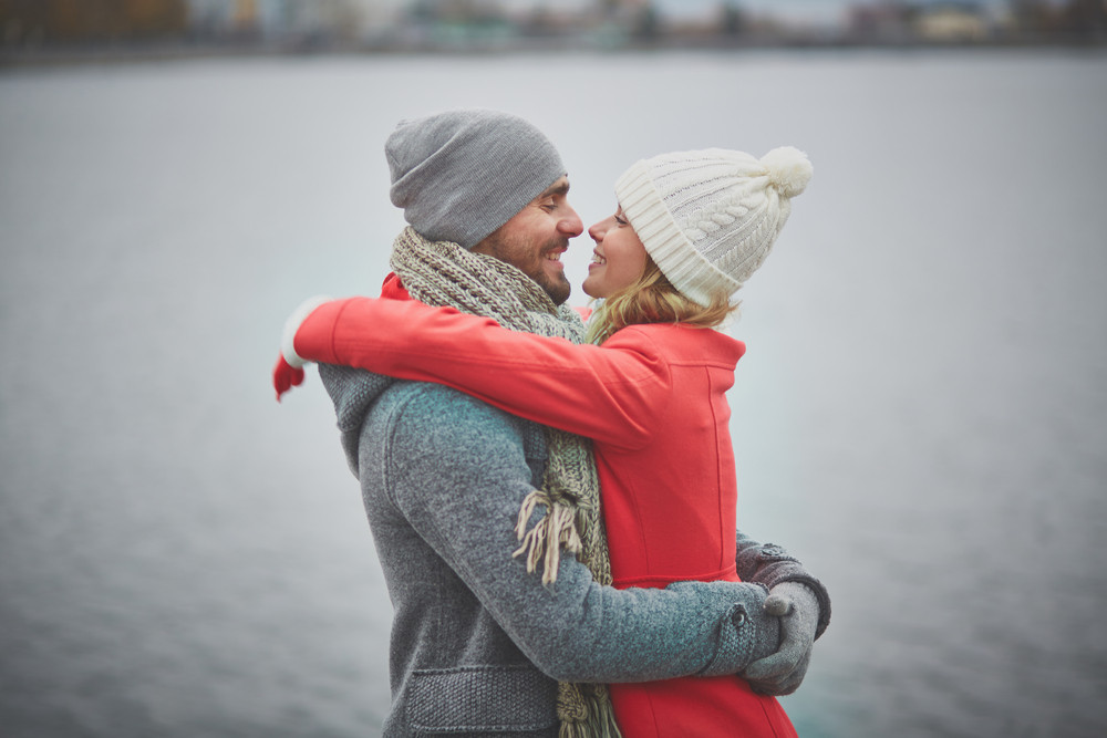 Portrait Of Happy Guy And His Girlfriend In Embrace
