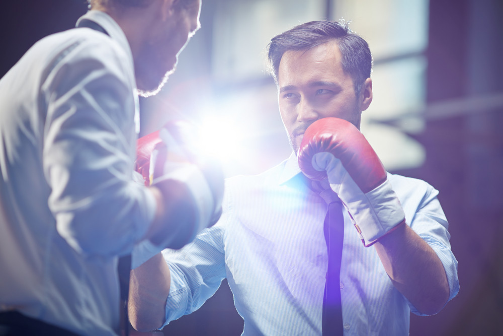 Serious Businessman In Boxing Gloves Looking At His Rival Before Attack