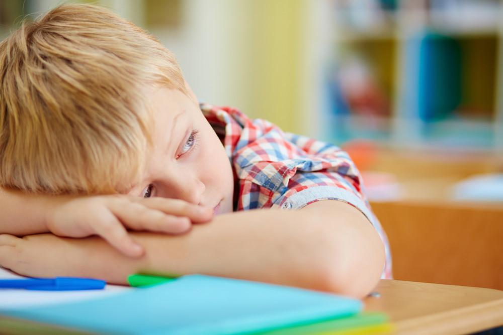 Tired Schoolboy Having Rest