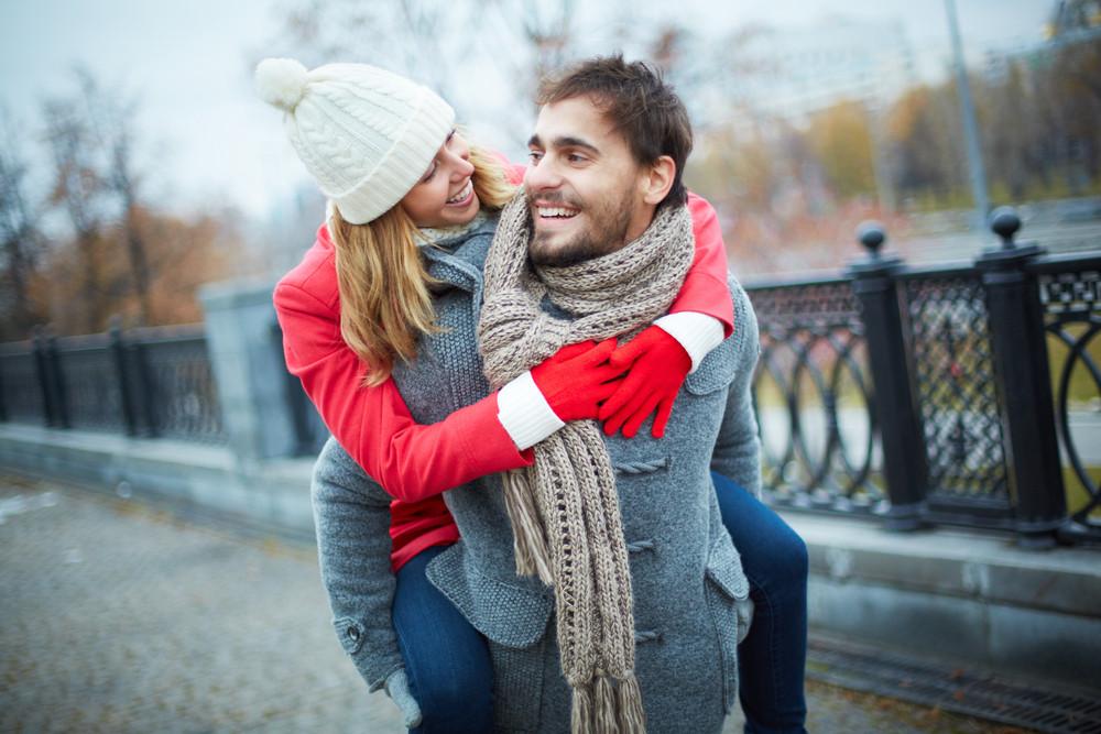 Image Of Affectionate Girl On Her Boyfriend Back In Park