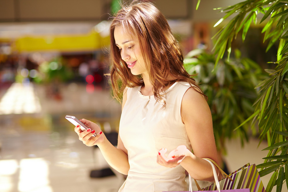 Pretty Shopper Reading Sms About New Sale Or Offer