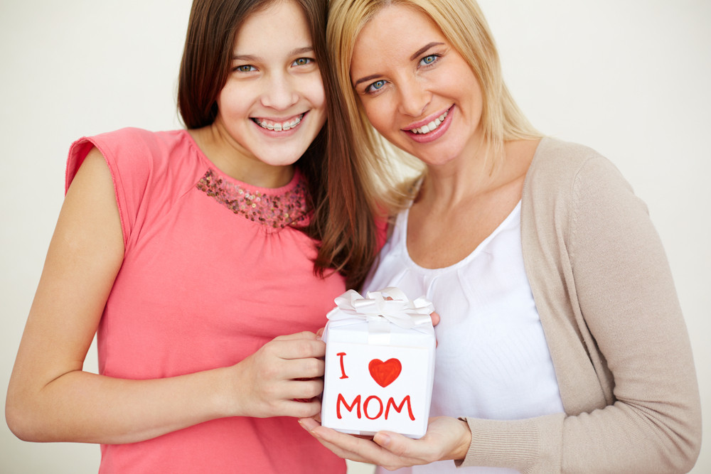 Teenage Girl And Her Mom Looking At Camera And Smiling