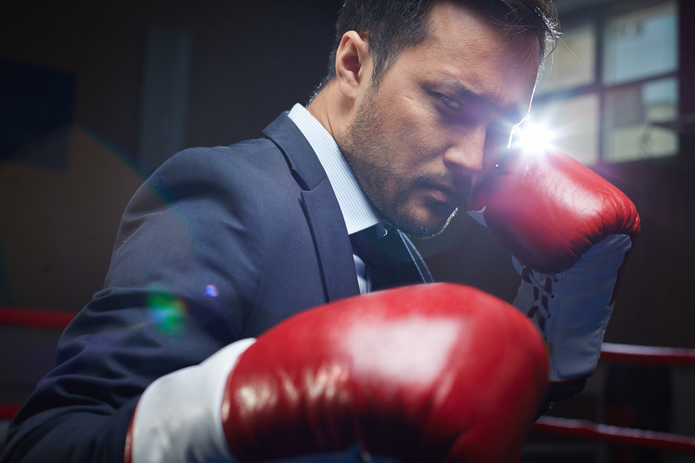 Asian Businessman Wearing Red Boxing Gloves
