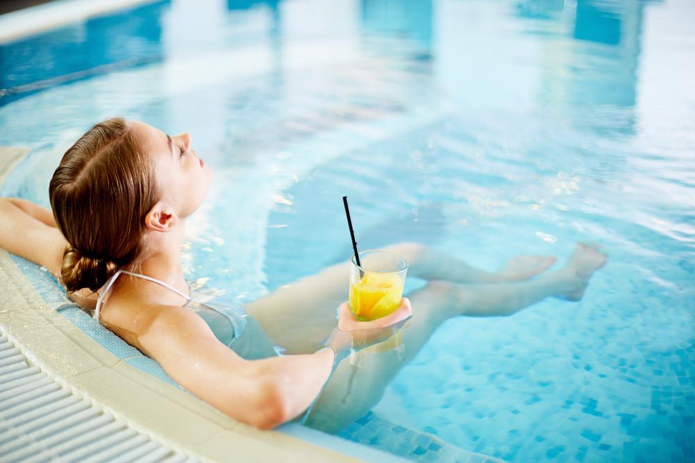 Woman Enjoying In Swimming Pool After Procedures
