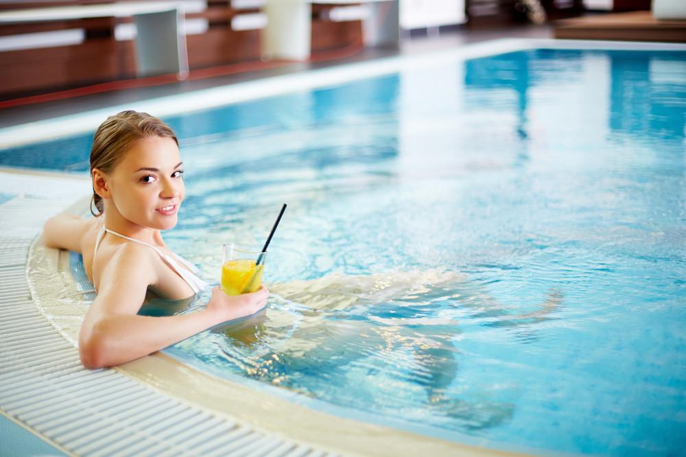Pretty Girl Relaxing In Swimming Pool
