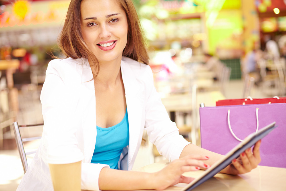 Attractive Shopper With Touchpad Looking At Camera With Smile
